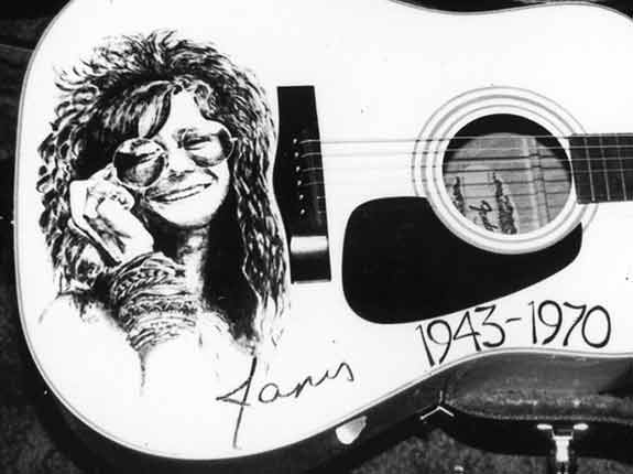 Portrait of Janis Joplin painted on an acoustic guitar by Nora Thompson